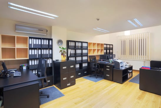 Interior of a small office showing how furniture placement can maximize space and functionality